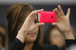 A student records video of lunchtime entertainment with her iPhone during the Sun Youth Forum at the Las Vegas Convention Center Tuesday, Nov. 24, 2009.