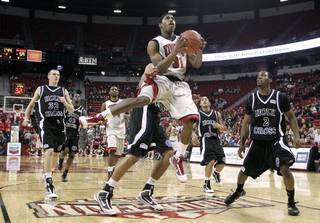 UNLV guard Justin Hawkins glides in for a basket against Holy Cross during the second half of the team's Nov. 25 game at the Thomas & Mack Center. UNLV won, 80-59, as Hawkins tallied 12 points.