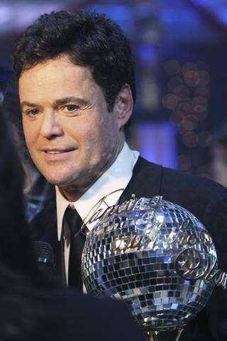 Donny Osmond and the mirrored disco ball trophy on the Season 9 finale of ABC's Dancing With the Stars.