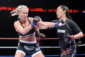 Latasha Marzolla trades punches with her opponent during a Tuff-N-Uff fight.