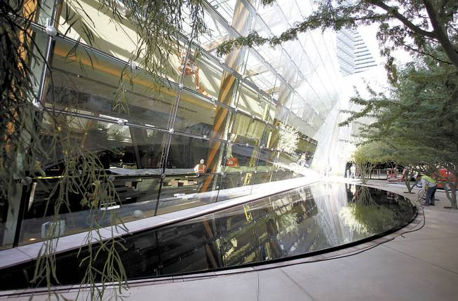 A reflecting pool surrounded by trees is one of the features of a pocket park between Aria, CityCenter's only gaming hotel, and the Crystals retail and dining area.