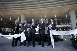 MGM Mirage executives cut a ribbon during the opening of the Vdara on Tuesday, Dec. 1, 2009. From left, Angela Lester, Vdara general manager, Bobby Baldwin, president and CEO of CityCenter, Jim Murren, MGM Mirage chairman/CEO, Bill Grounds, president/COO of Infinity World Development, a subsidiary of Dubai World, and Bill McBeath, president/COO of the Aria. The 57-story, 1,495-suite luxury property is the first to open in MGM Mirage's $8.5 billion CityCenter project.