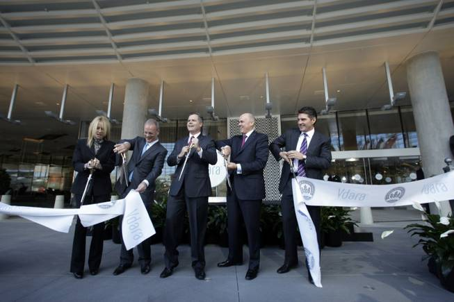 MGM Mirage executives cut a ribbon during the opening of ...