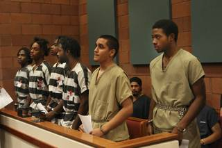 Defendants (from right) Prentice Marshall, 18; Adrian Pena, 17; Saul Williams Jr., 20; Emmitt Ferguson, 18; Michael Ferguson, 25; and Quadrae Scott, 18, appear for arraignment before Justice of the Peace Stephen J. Dahl on Dec. 2, 2009. They are facing charges in connection with the slaying of Metro Police Officer Trevor Nettleton, who was fatally shot in his garage Nov. 19 during what police have called an attempted robbery.