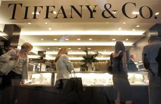 Invited guests examine the offerings at Tiffany & Co.'s 10,000-square-foot, two-level store at Crystals in City Center.