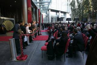 A ribbon of flowers is cut at the grand opening of the Mandarin Oriental at CityCenter, Friday, Dec. 4, 2009.