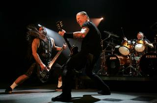 Metallica bassist Robert Trujillo, left, and guitarist James Hetfield perform during their sold-out show at the Mandalay Bay Events Center Saturday, December 5, 2009.