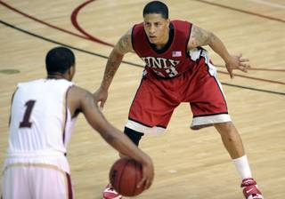 UNLV's Tre'von Willis, right, puts pressure on Santa Clara's Robert Smith during a Dec. 5 game at Santa Clara.