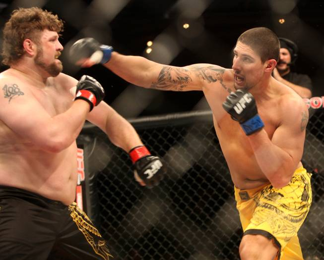 Brendan Schaub misses a right hand on Roy Nelson during the main event of the Ultimate Fighter Championship Saturday night at the Palms.   Nelson won the fight and the six-figure contract with the UFC.