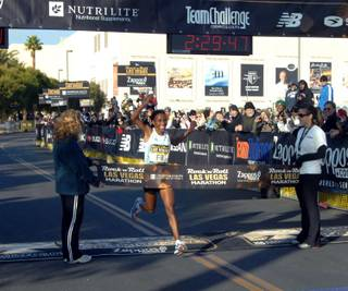 Kenyan runner Caroline Rotich becomes the first woman to cross the finish line at the 2009 Rock 'n' Roll Las Vegas Marathon on Dec. 6, 2009.