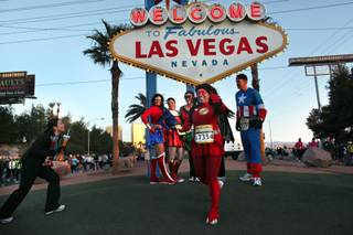 Runners dressed as super heroes stop for photos during the Rock 'n' Roll Las Vegas Marathon on Sunday, Dec. 6, 2009.