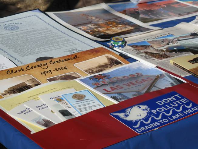Items to be placed in Clark County's time capsule included poker chips, documents and information about Lake Mead. The burying of the capsule at the Clark County Government Building marks the end of a year of festivities celebrating the county's centennial. The time capsule is set to be opened for the county's bicentennial celebration in 2109.
