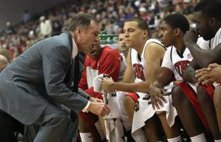 UNLV head coach Lon Kruger gets after his bench during the game Saturday as the Rebels take on Kansas St. at the Orleans Arena.  UNLV dropped their first game of the season 95-80