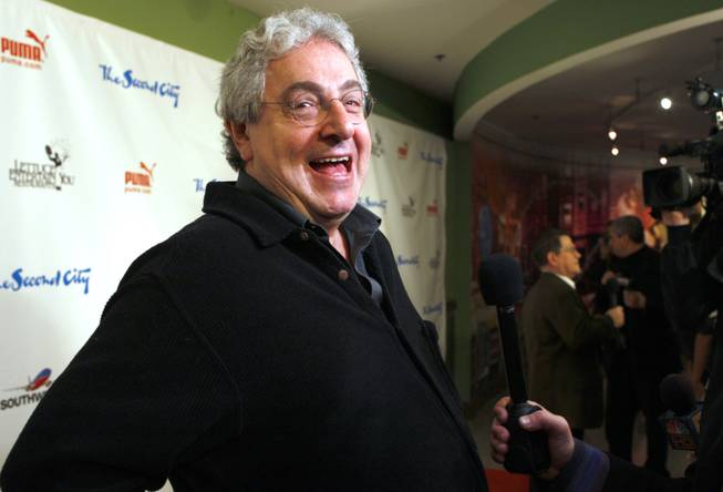 "In this Dec. 12, 2009 file photo, actor and director Harold Ramis laughs as he walks the Red Carpet  to celebrate The Second City's 50th anniversary  in Chicago.  An attorney for Ramis said the actor died Monday morning, Feb. 24, 2014, from complications of autoimmune inflammatory disease. He was 69. Ramis is best known for his roles in the comedies ""Ghostbusters"" and ""Stripes."""