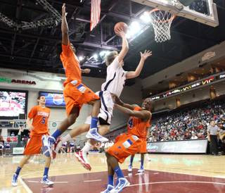 Marko Petrovic of Findlay Prep scores over the Bishop Gorman defense during Saturday's game at the Orleans Arena.
