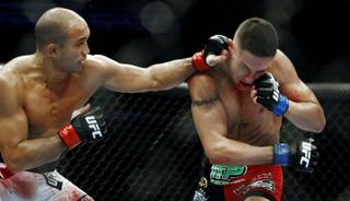 B.J. Penn lands a left hook to Diego Sanchez during their lightweight championship fight at FedEx Forum in Memphis, Tenn., on Dec. 12, 2009. Penn ended up winning the fight by TKO in the final round.
