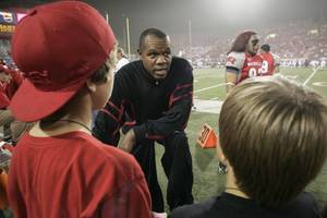 Former UNLV quarterback and NFL star Randall Cunningham talks to young fans before the start of UNLV's game against Utah on Oct. 17, 2009, at Sam Boyd Stadium. Cunnigham recently joined the Silverado High football coaching staff as offensive coordinator.