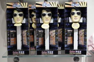 Elvis Presley giant PEZ dispensers are displayed at the official Viva ELVIS store at Aria Tuesday, December 15, 2009. Preview performances for the new show by Cirque du Soleil will begin Friday, December 18. Aria, the centerpiece of the $8.5 billion project, will open after a fireworks display Wednesday night. The development is a partnership between MGM Mirage and Dubai World.  .