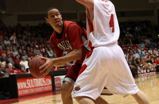 UNLV forward Chace Stanback looks to score against Jake Nielson Tuesday as the Rebels take on Southern Utah at the Centrum Arena in Cedar City, Utah. UNLV dominated the second half and came out with a 77-59 win.