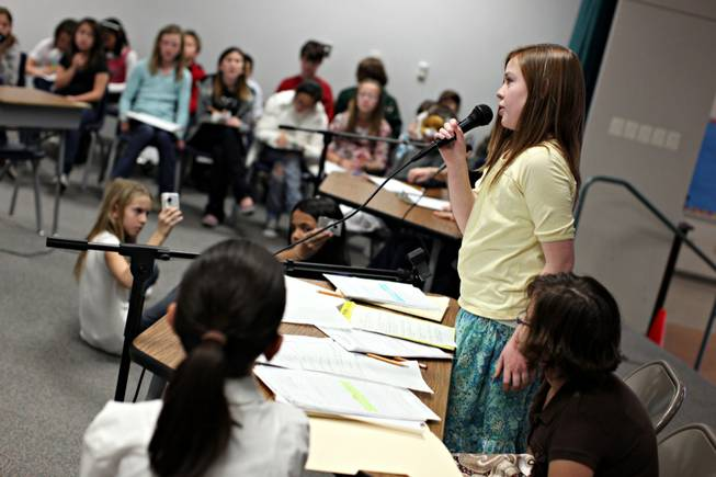 Fifth-grader Caroline Hawley, 11, acts as a prosecutor making her closing argument Tuesday during a mock trial staged by Gifted and Talented Education students at Heckethorn Elementary School.