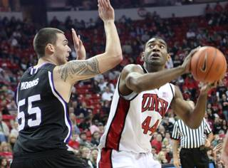 UNLV forward Darris Santee looks to score against Weber State's Trevor Morris during the game Thursday at the Thomas & Mack Center. UNLV came out on top, 72-63.