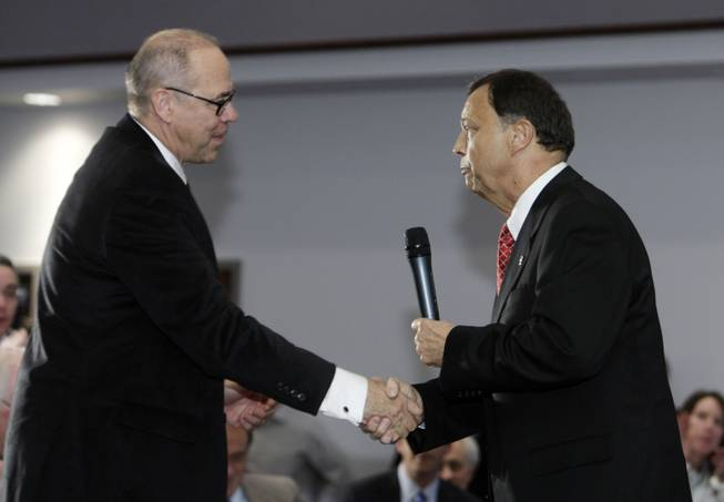 Jim Livengood, right, former University of Arizona athletic director, shakes hands with UNLV president Neal Smatresk during a news conference at UNLV announcing Livengood as the new UNLV athletic director Thursday, December 17, 2009.