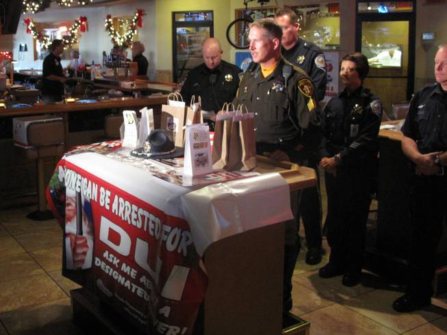 Metro Police Sgt. Richard Strader speaks at the T-Bird Lounge about law enforcement's plans to crack down on drunken driving during the holidays.