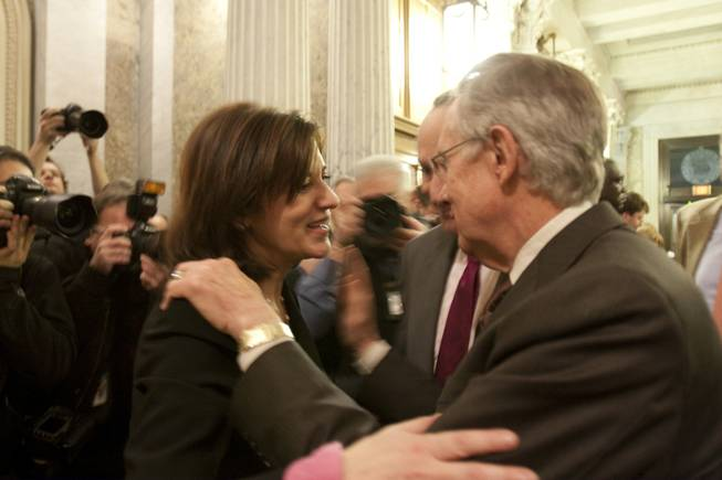 Victoria Reggie Kennedy, widow of the late Sen. Ted Kennedy, greets Senate Majority Leader Harry Reid, D-Nev., as Sen. Chuck Schumer, D-N.Y., center, looks on following a 60-40 cloture vote which is the first step on passing a health care bill on Capitol Hill in Washington, Monday, Dec. 21, 2009.