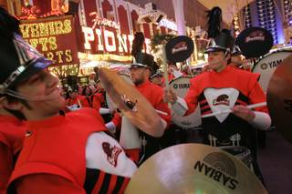 The Oregon State drum line performs at a pep rally on Fremont Street for the Vegas Bowl game between Oregon State and BYU Monday, December 21, 2009.