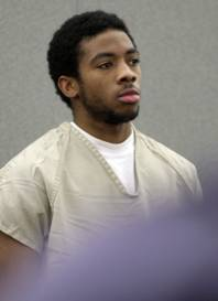 Prentice Marshall appears in District Court during an arraignment at the Regional Justice Center on Wednesday, Dec. 23, 2009. Six defendants entered not guilty pleas to charges related to the slaying of Metro Police officer Trevor Nettleton last month.