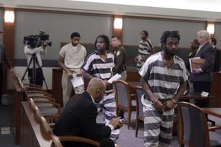 From left to right, Saul Williams Jr., Quadrae Scott, Prentice Marshall, Michael Ferguson, Emmitt Ferguson and Adrian Pena appear in District Court during an initial arraignment at the Regional Justice Center on Wednesday, Dec. 23, 2009. The defendants entered not guilty pleas to charges related to the slaying of Metro Police officer Trevor Nettleton last month.