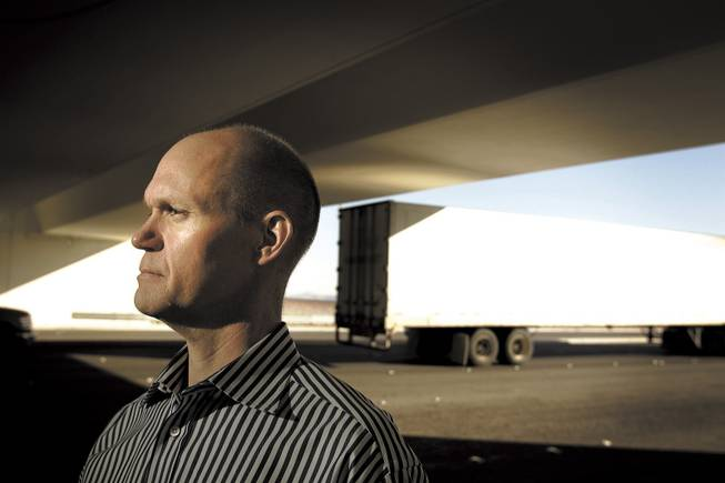 Tom Skancke, who envisions high-speed rail being built in Las Vegas, stands at the Interstate 215 underpass at Decatur Boulevard.