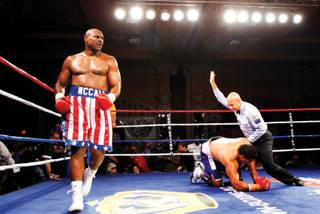 THE WINNER IS ... Oliver McCall walks around the ring as referee Joe Cortez calls off the heavyweight fight May 22 with John Hopoate of Australia at the Orleans. McCall beat Hopoate, a former rugby player, with a second-round knockout.