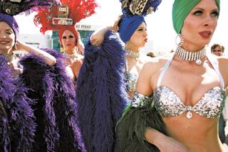 THREE, TWO ... Showgirls, from left, Johanna V., Kari Richards, Jennifer Speelman and J.P. Howard before the NASCAR race in Las Vegas in March.