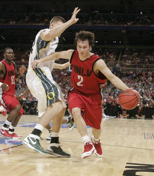 Point guard Kevin Kruger looks for dribbling room against Oregon during the 2007 Sweet 16.