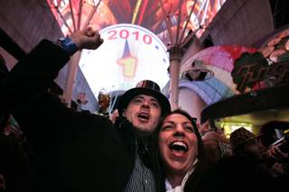 Brian Flynn and Ayme Hosseini of Orange County, Calif., ring in the new year just before the stroke of midnight during New Year's 2010 TributePalooza at the Fremont Street Experience in downtown Las Vegas Thursday, December 31, 2009.