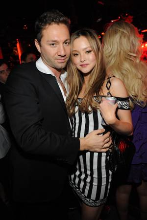 Jason Strauss and Devon Aoki at Tao in The Venetian on New Year's Eve 2009.