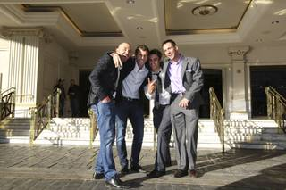 After a full night of partying, new friends, from left, Anthony Peti and Marcus Auralius, of Italy, and Jack Francis and Deryyn Websterknife, of Australia, head out of Caesars Palace to find something to eat New Year's Day morning.