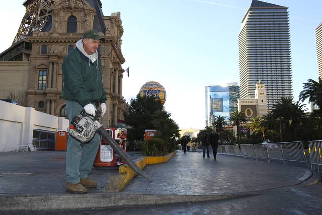Bally's employee Craig Mackelprang cleans the sidewalks on New Year's Day 2010 following the New Year's Eve celebration on the Las Vegas Strip.