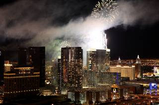Fireworks ring in the new year on the Las Vegas Strip on Jan. 1, 2010. The Strip's newest casino, Aria, was one of seven casino rooftops that lit up the midnight sky with fireworks.