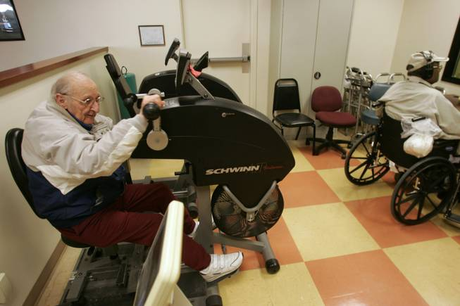 Vincent Cravero, above, uses an exercise machine at the facility last week.