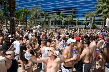 Crowds pack the Hard Rock Hotel's Rehab pool party.