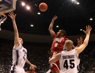 UNLV guard Oscar Bellfield shoots a runner against BYU on Wednesday at the Marriott Center in Provo, Utah.