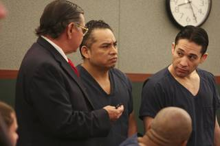 Porfirio Duarte-Herrara, right, and Omar Rueda-Denvers, center, listen to a court interpreter as District Court Judge Michael P. Villani sentences Rueda-Denvers to life without parole Thursday at the Regional Justice Center.  Rueda-Denvers was sentenced to life without parole and Duarte-Herrera will be sentenced Jan. 28 for killing Willebaldo Dorantes Antonio after placing a pipe bomb on his truck at the Luxor parking garage in May 2007.