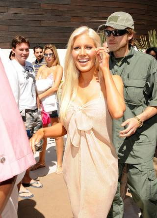 Heidi Montag hosts at Liquid Pool Lounge in Aria on April 10, 2010. Husband Spencer Pratt is with her.
