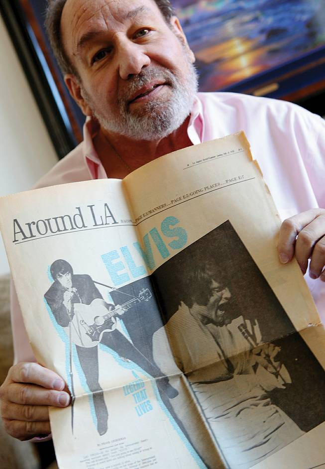 Longtime Las Vegas journalist Frank Lieberman holds a printed copy of his interview with Elvis, which appeared in the <em>Los Angeles Herald-Examiner</em> on Feb. 8, 1970.