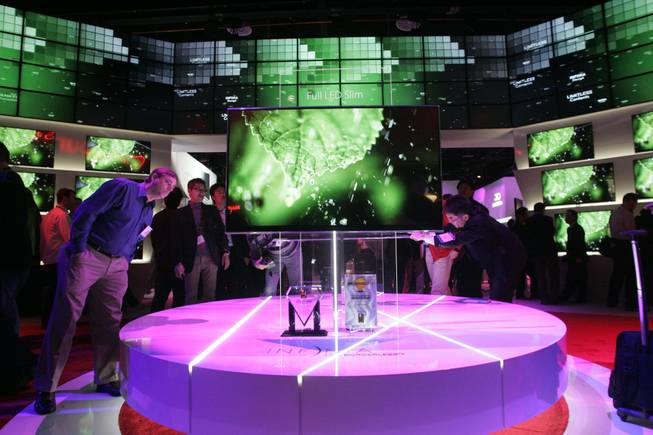 An attendee checks out LG's LE9500 series television at CES Friday.