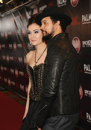 "Sasha Grey and her husband, Iann Cinnamon, a man who Dave Attell referred to as, ""a drug dealer from the '70s."""