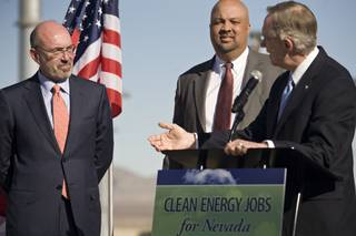 LS Power Chairman and CEO Mike Segel, left, and Western Area Power Authority Administrator Tim Meeks listen as Sen. Harry Reid speaks to media during a press conference at the Harry Allen Generating Plant near Apex, Nev., on Monday, Jan. 11.