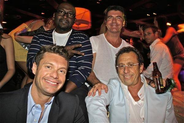 Clockwise from front left, <em>American Idol</em>'s Ryan Seacrest, Randy Jackson and Simon Cowell with Victor Drai in Victor's VIP booth at XS in the Encore on April 27, 2009.
